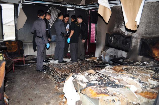 A man was killed and 11 people were injured when a fire broke out at the Grand Tower Inn Hotel in Khlong San district early yesterday, with police suspecting the blaze was an act of arson.