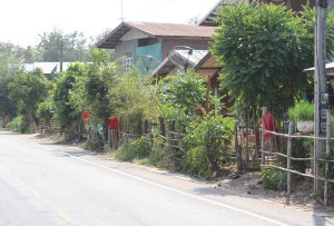 Red Shirts Hanging in front of homes in Village