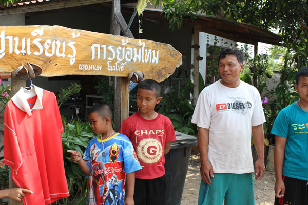 """Villagers point to hanging red shirts in front of their home to repel a """"widow ghost"""""""