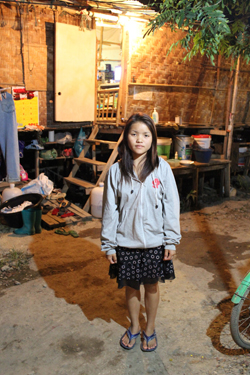 Nong Foung, an 18-year-old immigrant from Taunggyi, the capital of Shan State in Myanmar. She works from 7 a.m. to 6 p.m. seven days a week pouring concrete at a nearby residential construction site.