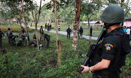 Up to 60 insurgents wearing military fatigues approached the base at about 1 a.m. in Narathiwat province