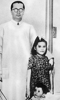 Lina Medina, accompanied by her 11-month-old-son Gerardo, and Dr Lozada who helped with the birth. The picture was taken in 1939 in a hospital in Lima, Peru's capital