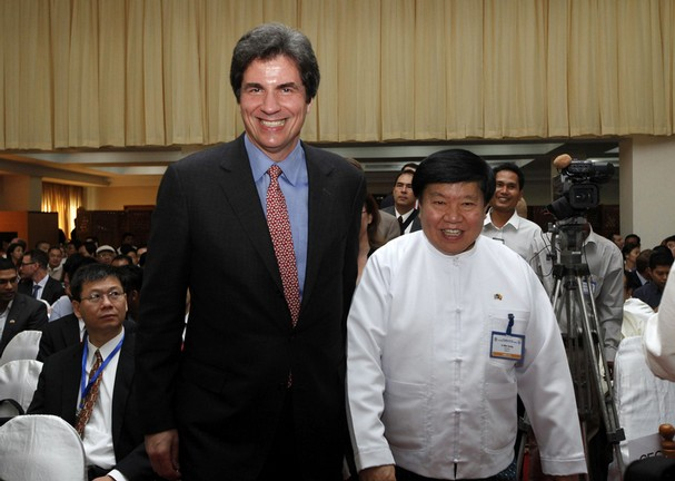 """Myanmar Federation of Chamber of Commerce and Industry President Win Aung, right, smiles with U.S. Assistant Secretary of State for Economic and Business Affairs Jose Fernandez during a conference titled """"U.S.-Myanmar Economic Relations"""