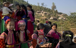 Lisu children and women in traditional clothing gather outside the Ywar Thar Yar village's school, central Shan state, Myanmar