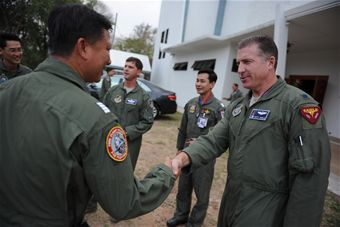 Lt. Col. David Eaglin (right) greets Royal Thai air force and Republic of Singapore air force military counterparts before a multilateral in-brief during Cope Tiger 13 Field Training Exercise