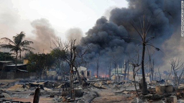 Smoke rises from burning houses around a mosque in riot-hit Meiktila in central Myanmar on Thursday