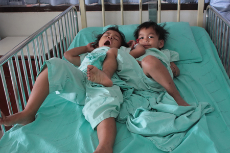 The two youngest children recovering in Trang hospital after their father admitted giving his three children rat poison. Photo by Methee Muangkaew
