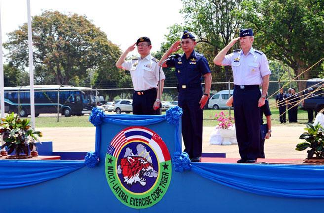 Singapore's Chief of Air Force (Designate) Brigadier-General Hoo Cher Mou (L), Commander-in-Chief of the Royal Thai Air Force Air Chief Marshal Prajin Juntong (C) and Commander of the Pacific Air Forces General Herbert J Carlisle (R) officiating at the Closing Ceremony of Exercise Cope Tiger 2013.