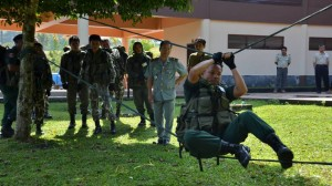 Strong-arm tactics: National park rangers go through their paces at a training session in Thailand held by the Freeland Foundation, an NGO that specializes in tracking wildlife crime and exposing criminal syndicates, as well as developing alternative livelihoods for poachers.