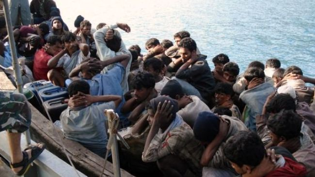 Human Rights Watch says sailors opened fire on around 20 Rohingya migrants, killing two of them, as they jumped overboard to escape custody after drifting into Thai waters