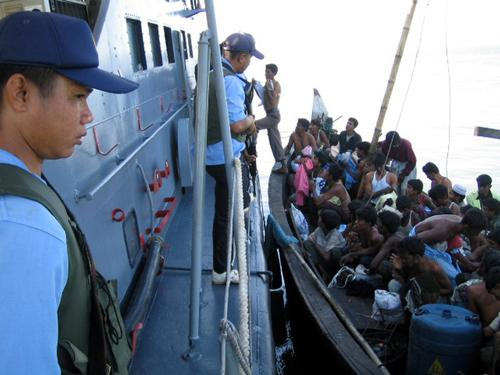 Orders to the Thai Navy are that Rohingya boats found attempting to reach Thai shores should be provided with food, water, medicines and gasoline before being towed back to sea: Commander-in-Chief Admiral Surasak Rounroengrom
