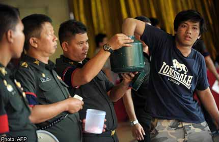 Thai man taking part in April's army recruitment lottery
