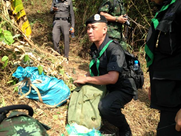 Thai para-military officer holding sack containing 120,000 speed pills.