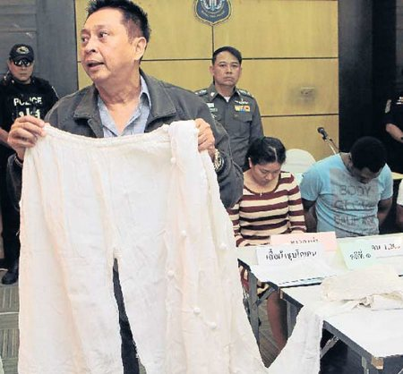 Narcotics Suppression Bureau deputy chief Pol Maj Gen Suraphon Thuanthong, at a Friday press conference, holds one of three items of clothing that were soaked in water mixed with about 1.2kg of cocaine before being dried and sent from Argentina to Thailand. (Photo by Apichit Jinakul)
