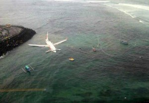 Images of the incident site showed the plane partially submerged in the water with inflatable slides deployed from the front exits