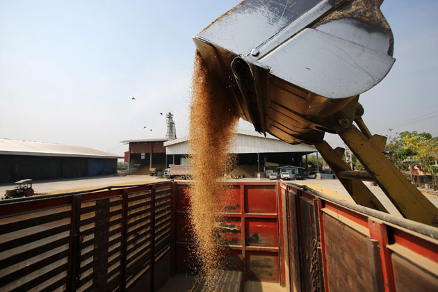 Harvested and dried rice is loaded onto a truck at the Sahakorn Kan Kasert rice mill in Suphan Buri, Thailand