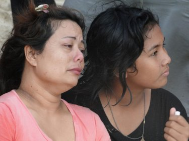 A mother and a sister waited for the tragic news that came today Photo by phuketwan.com
