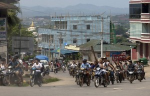 Hundreds of Buddhists on motorcycles armed with sticks patrol in the streets of in Lashio, northern Shan State, Myanmar