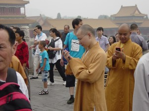 Monks checking out iPhones