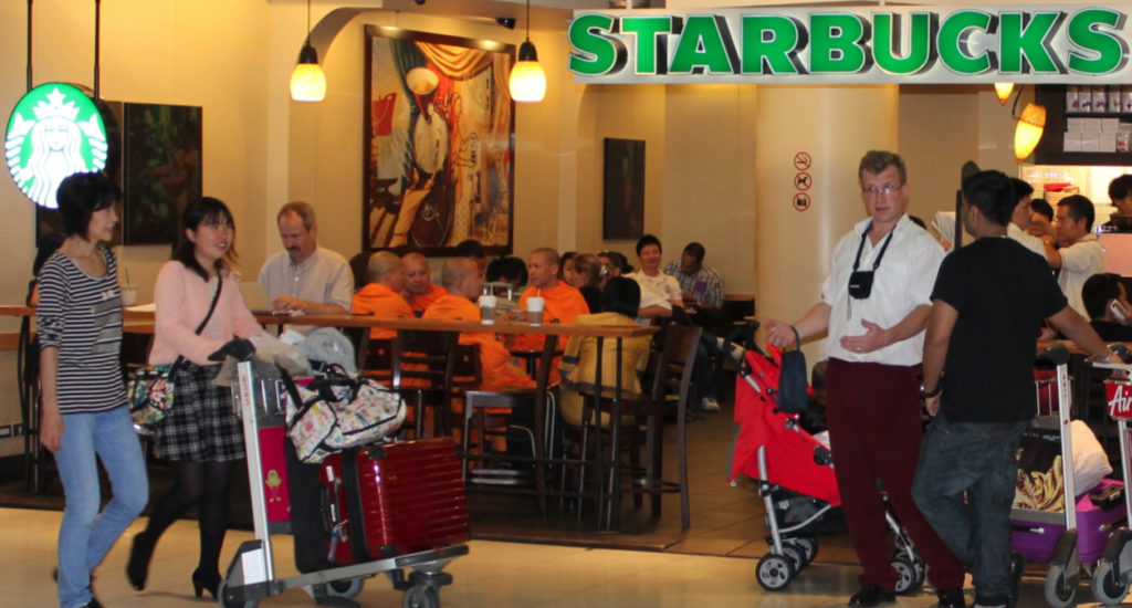 Monks sipping Starbucks coffee in the United States