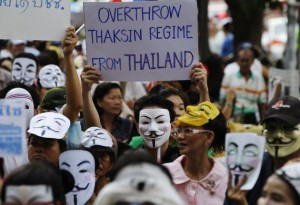 Anti-government protesters wearing official and homemade versions of the mask attend a rally outside a shopping mall in Bangkok.