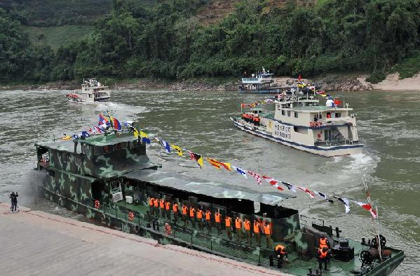 Patrol boats carrying police officers from China, Laos, Myanmar and Thailand leave Guanlei Port in Dai Autonomous Prefecture of Xishuangbanna, southwest China's Yunnan Province