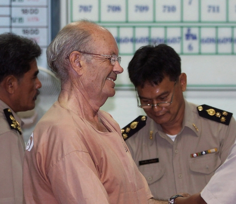 British national David John Fletcher is handcuffed before being ltaken to the Appeals Court on Wednesday. He was ordered extradited to Cambodia to serve a rape conviction sentence