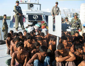 Rohingya boat people guarded by Military