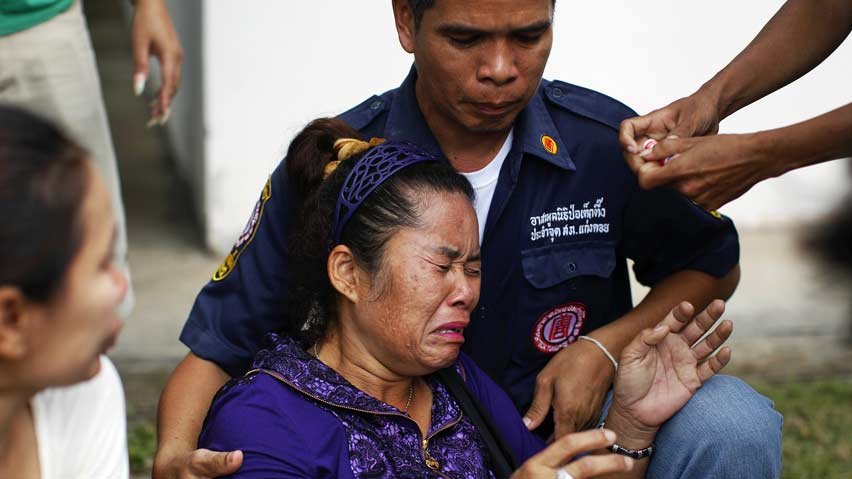 Medical staff comfort Piyathida Wongsungyang, who lost two relatives in the crash after she arrived at a hospital in Kanghoi, Saraburi province