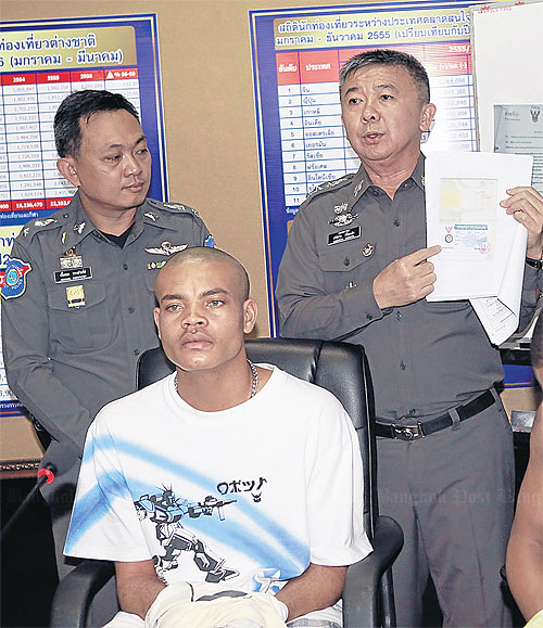 Nigerian tourist Nnamdi Igbolekwe, 23, after tourist police arrested him yesterday on Soi Nana. Please credit and share this article with others using this link:http://www.bangkokpost.com/news/local/366248/surapong-dismisses-terror-link-to-stolen-visas. View our policies at http://goo.gl/9HgTd and http://goo.gl/ou6Ip. © Post Publishing PCL. All rights reserved.