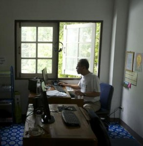 The reporter Kyaw Thaung at work in his office on the outskirts of Bangkok