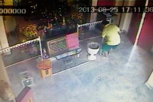 A CCTV screen grab shows Menichelli fishing in the donation box. - See more at: http://www.thephuketnews.com/italian-caught-robbing-phuket-temple-donation-box-41592.php#sthash.coYiHRZ4.dpuf