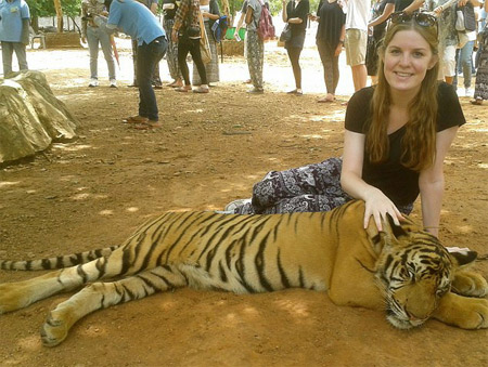 minutes after this photo was taken, another 400lb tiger leapt into the frame, knocking the 19-year-old to the ground with its paw and sinking its teeth into her thigh.