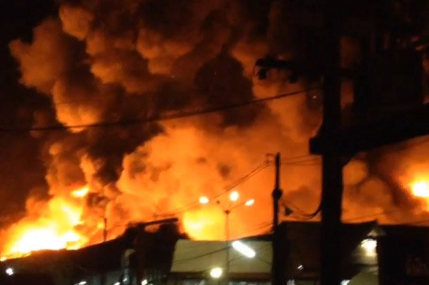 """A huge blaze is burning at the main SuperCheap store in Phuket City, the main town on the island of Phuket, with firefighters reportedly unable to reach the """"out of control"""" inferno."""