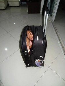 Girl tucked away in his suitcase