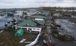 Philippine military C130 cargo planes (L) ferrying supplies park at the tarmac outside an airport after super Typhoon Haiyan battered Tacloban city in central Philippines November 9, 2013.