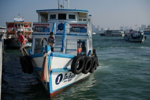 A double-decker boat arrives at a pier in Pattaya on Monday. Rescuers recounted frantic efforts to pluck terrified survivors from the sea after a crowded tourist ferry carrying about 200 people sank