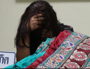 Aizawl Lalchhuanthangi, charged with smuggling meth from India into Thailand, hides her face at a press conference. Photo: Kritsada Mueanhawong