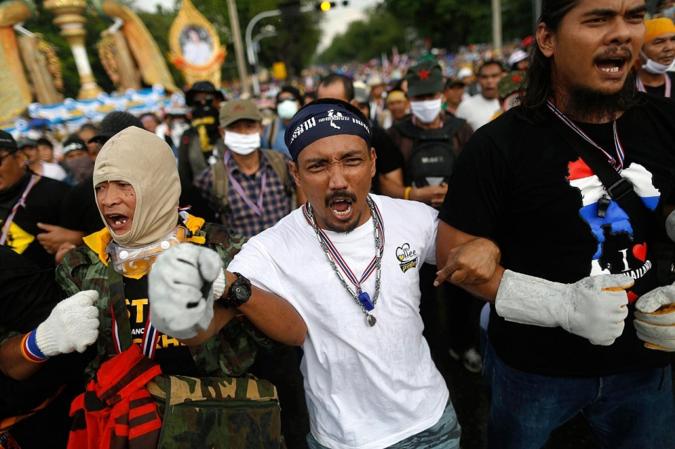 Protesters shout as they get ready to attack a police barricade Monday. Damir Sagolj