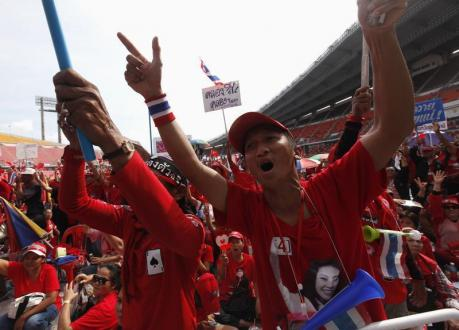 Pro-government ''red shirt'' supporters react during a rally as they await a court decision, at Rajamangala national stadium in Bangkok