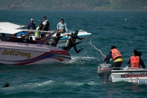 Thai rescue divers search the waters where a double-decker ferry sank near Koh Larn island, a small island popular with day-trippers from the Thai resort area of Pattaya