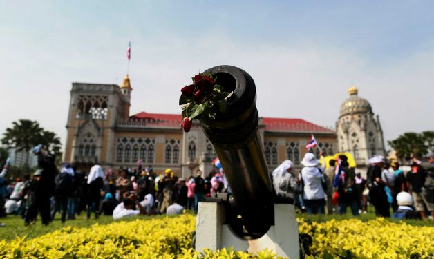Anti-government protesters swarmed into the Thai prime minister's office compound Tuesday as police stood by and watched, allowing them to claim a symbolic victory after three days of bitter clashes. (AP photo/Wason Wanichakorn)