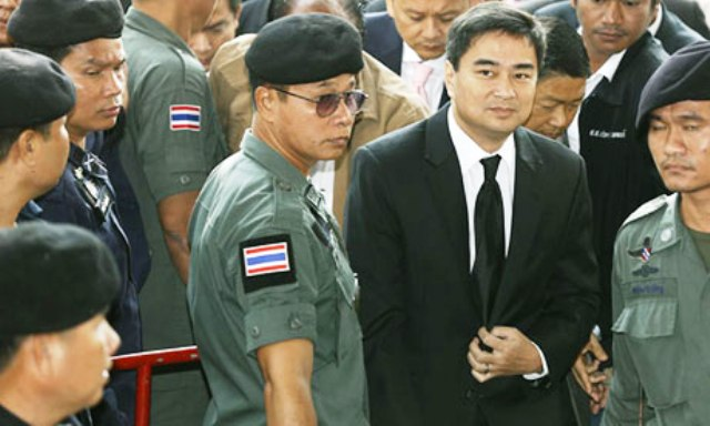 Abhisit Vejjajiva, the former Thai prime minister and leader of the opposition Democrat party, arrives at criminal court in Bangkok. Photograph: Narong Sangnak/EPA