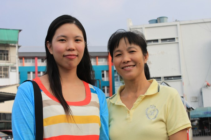 While they're glad to be free and safe in Thailand, Chinese nationals Feng Xiaoxin and her mother He Zhiwei remain concerned about the fate of Faun Gong practitioners in China who are being persecuted by communist authorities. (Cameron McKinley/Epoch Times)