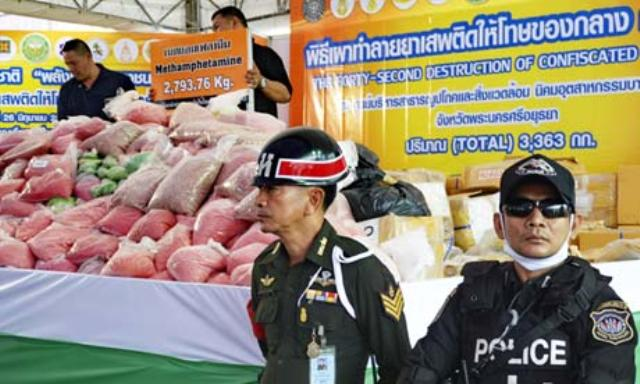 Thai police with confiscated methamphetamine. Amphetamine users in south-east Asia are at greater risk of contracting HIV