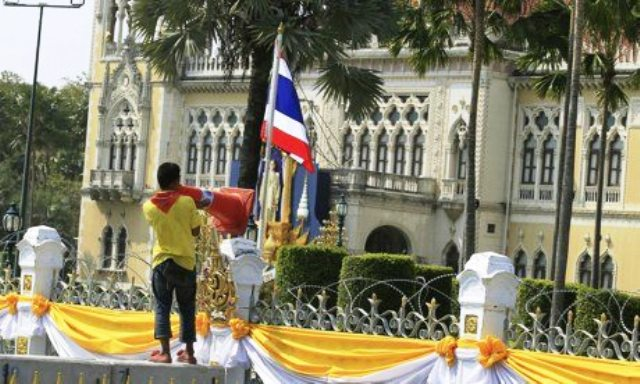 A protester shouts anti-government slogans outside a police barricade in front of Government House in Bangkok. Photograph: Narong Sangnak/EPA