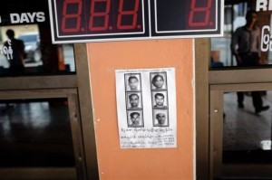 A wanted poster for six Rohingya Muslims who escaped from a police immigration detention centre is seen in the port city of Ranong in southern Thailand October 30, 2013. REUTERS/Andrew RC Marshall