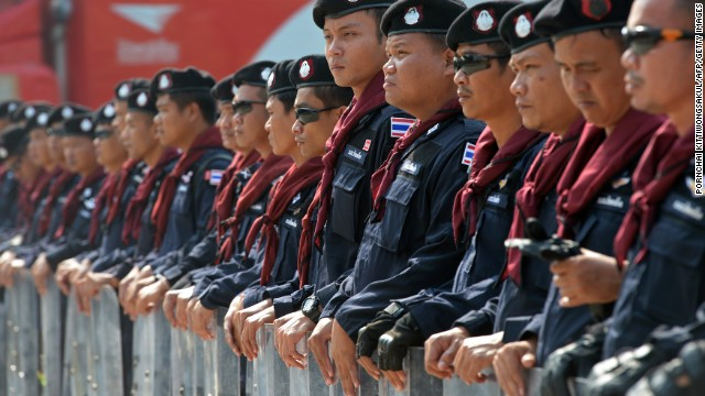 Thai riot police stand guard during a demonstration in Bangkok