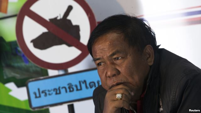 """Kwanchai Praipana, a pro-government """"red shirt"""" leader, is seen during an interview with Reuters at a radio station he owns in Udon"""