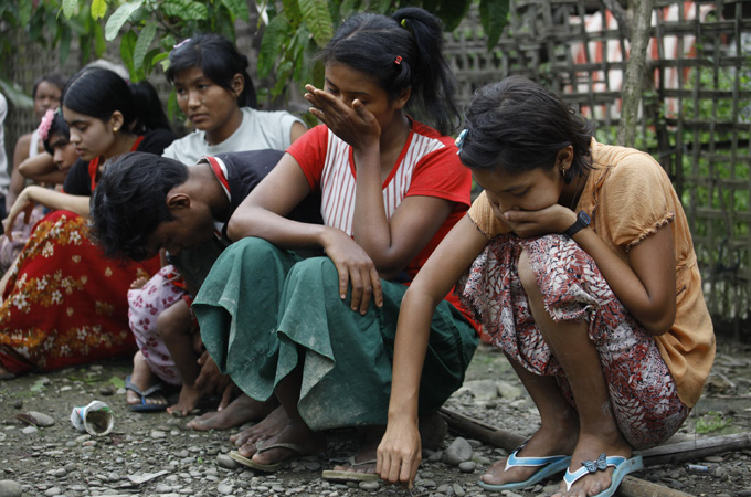 Muslims cry after losing their homes in recent violence in Thapyuchai village, outside of Thandwe in the Rakhine state